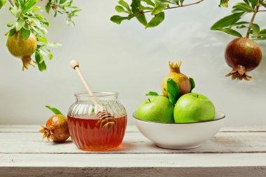 honey jar, apples and pomegranate tree