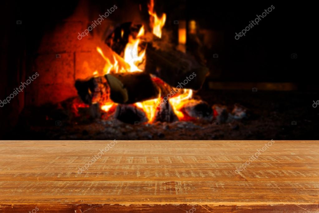 Wooden table over fireplace