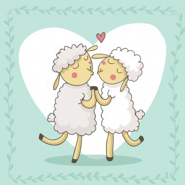 Two cute lambs kissing