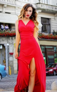 Beautiful young woman in red dress