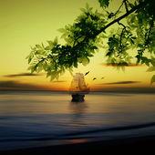 Fotografie plachetnice při východu slunce