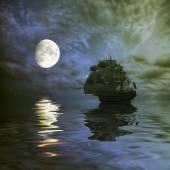Fotografia barca a vela durante lalba