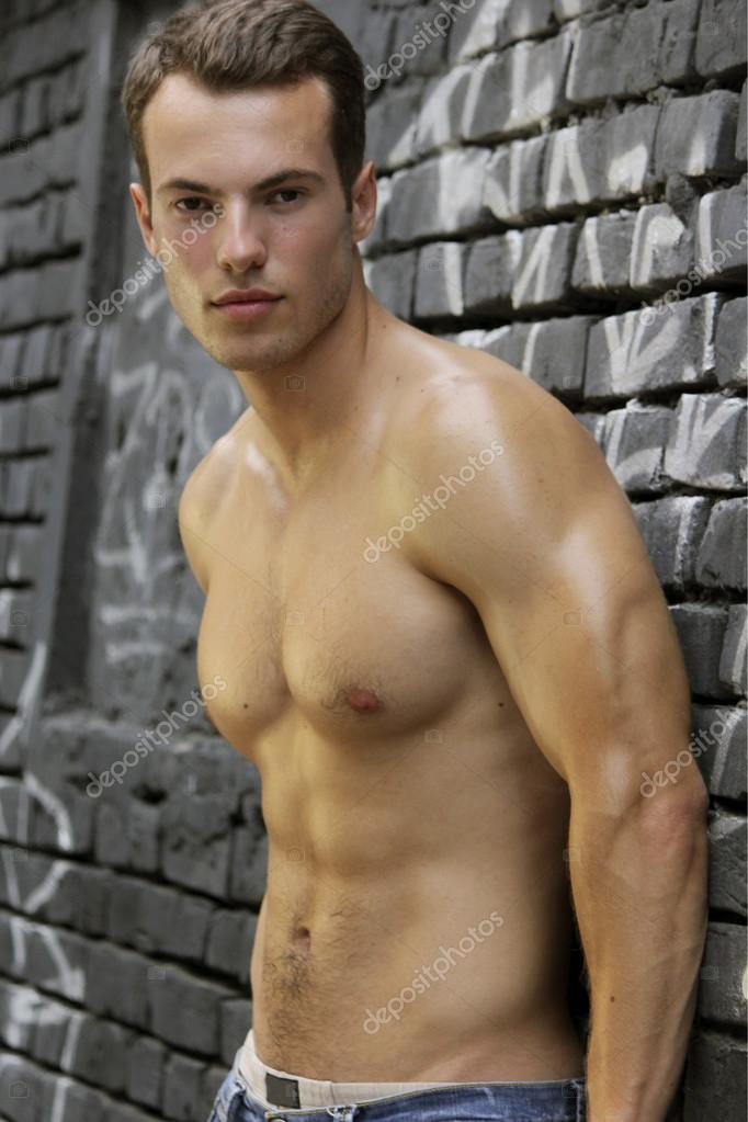 Young handsome man with beautiful muscular body.