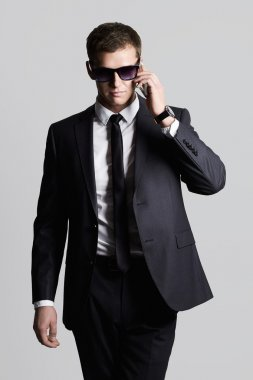 businessman speaking on the phone.