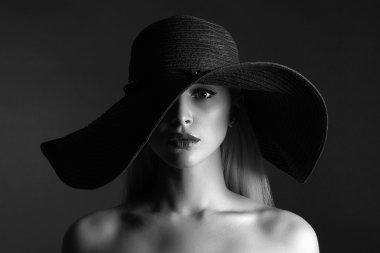monochrome portrait of Beautiful woman in hat.fashion beauty girl