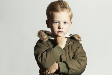 Fashionable child in winter coat. fashion kid.children.khaki parka.little boy hairstyle