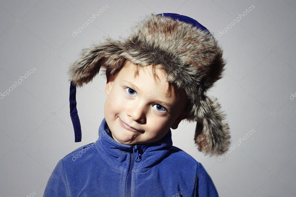 b334be30aedb Funny child in fur Hat.fashion casual winter style.little boy in ...