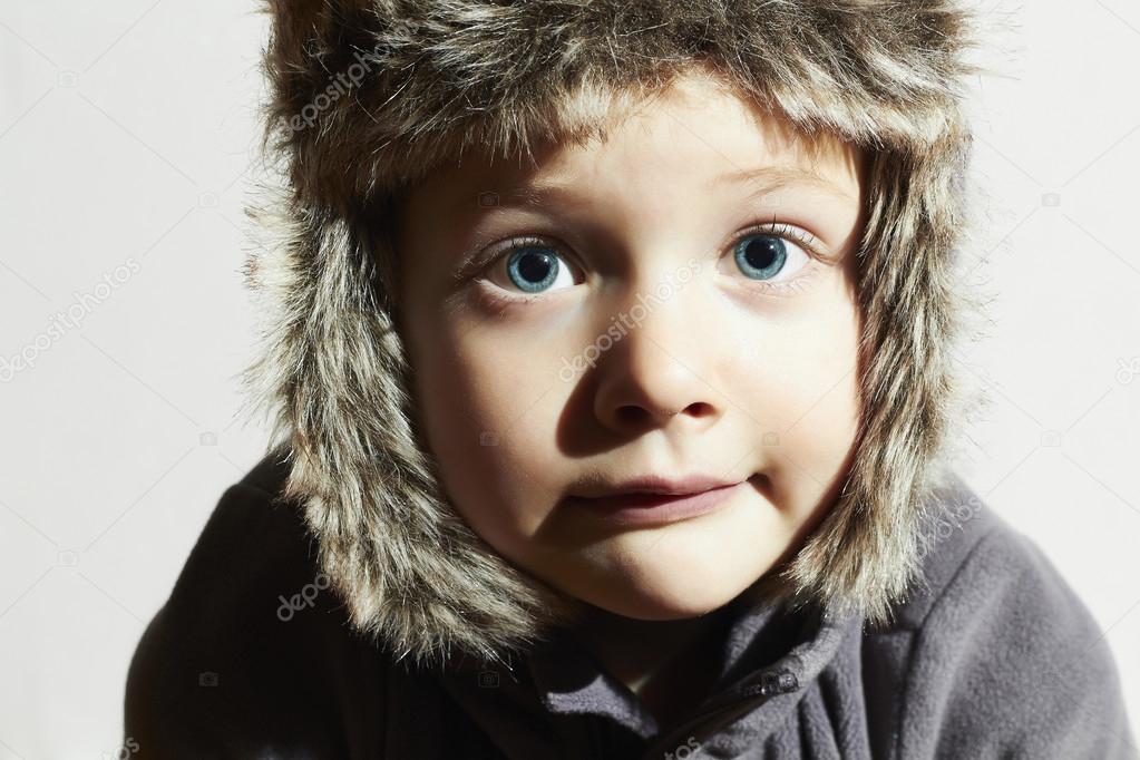 4d531990b12e Funny child in fur Hat.fashion casual winter style.little boy ...