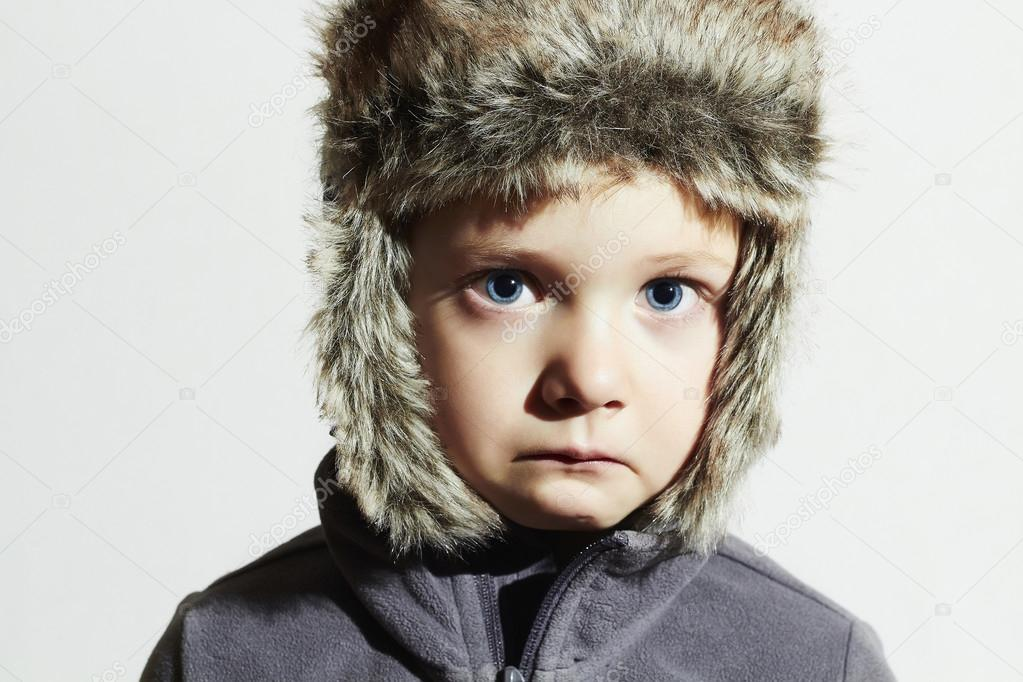 825a55b6e161 Sad child in fur Hat.Kids casual winter style.close-up funny ...