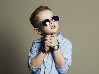 Handsome little boy in sunglasses.Funny Child