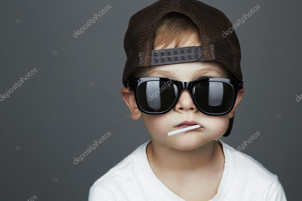 Funny Young Boy Eating A Lollipop