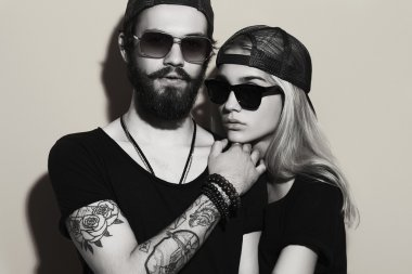 beautiful couple together. Tattoo Hipster boy and girl. Bearded young man and blonde in sunglasses