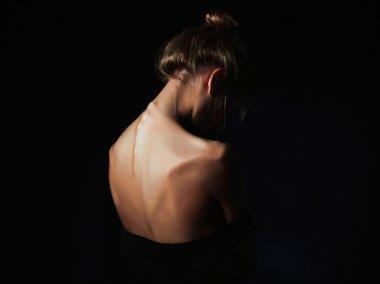young woman with naked back. sad girl