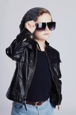 Funny child in hat.fashionable little boy in sunglasses.stylish kid in leather