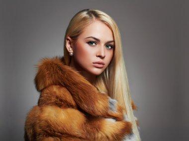 beautiful Woman in Fur Coat. winter Beauty Fashion Model Girl