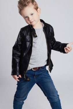 Fashionable child in leather coat.little boy. Autumn fashion.funny kid