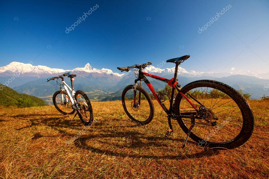 Two bikes on the background of the himalayan mountains stock photo two bikes on the background of the himalayan mountains stock photo voltagebd Image collections