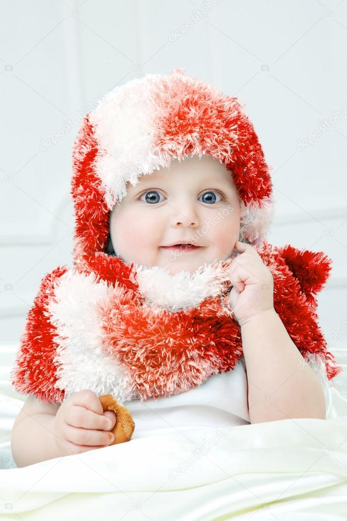 a3b3aca158ac Cute baby at winter background — Stock Photo © MyGoodImages  87764080
