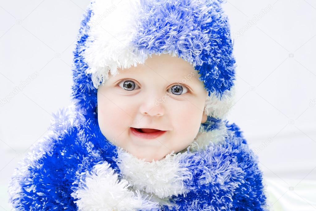 367682a2ed77 Cute baby at winter background — Stock Photo © MyGoodImages  87764086