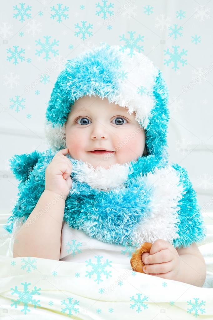 b5f63b88a580 Cute baby at winter background — Stock Photo © MyGoodImages  88562332
