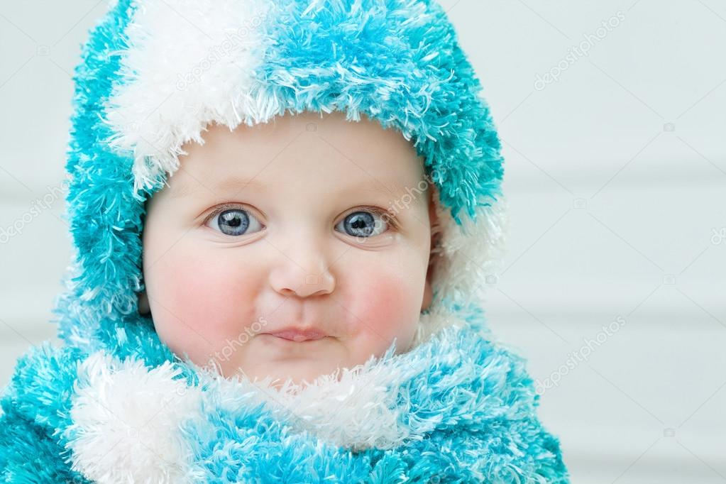 1ee712bf447e Cute baby at winter background — Stock Photo © MyGoodImages  92143100