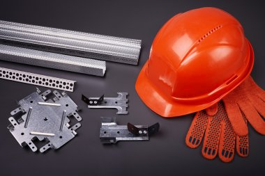 Construction helmet and fasteners