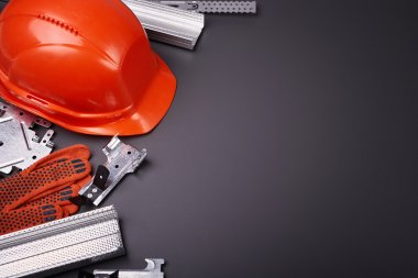 Helmet, gloves and construction material