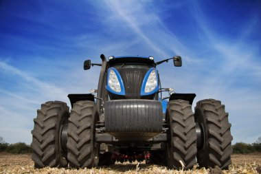 Tractor with big wheels in the field