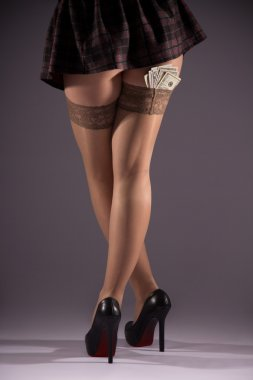 Beautiful legs in stockings and dollars