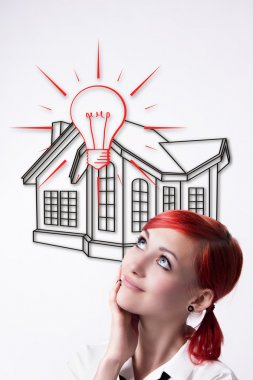 Red-haired girl dreams of your own home