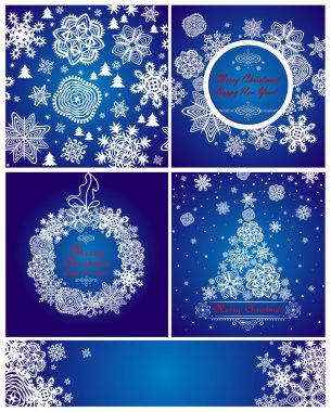 Blue christmas greeting cards with paper snowflakes