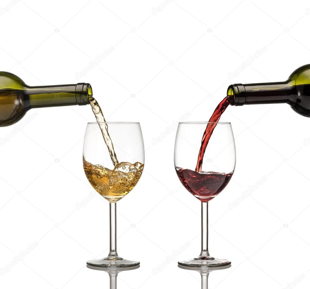 Red and white wine being poured into wine glass on white ...