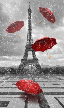 Eiffel tower with flying umbrellas.