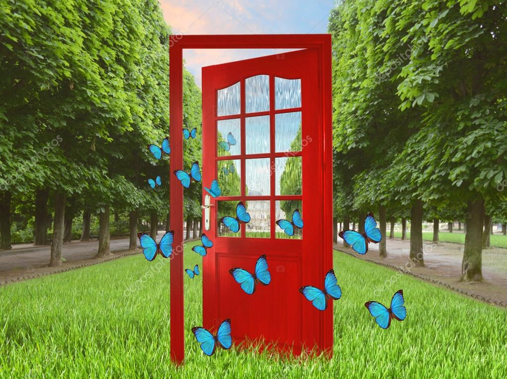 Open door in green garden and flying butterflies