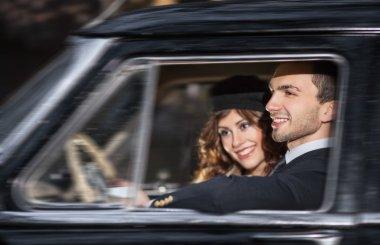 A young couple with a retro car
