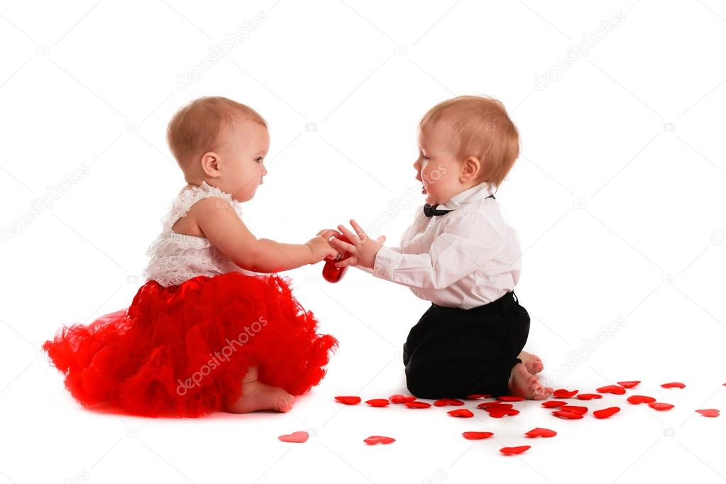 2db51274a70a couple girl and boy babies playing with hearts concept valentine ...