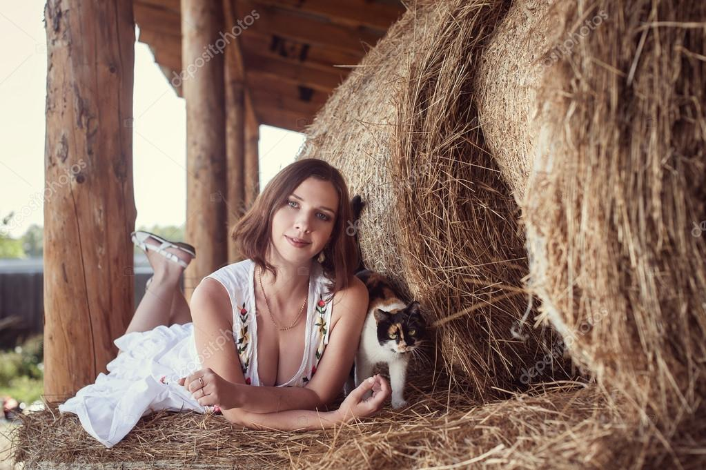 Attractive girl in hay