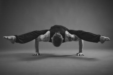 Yoga Man posing in studio