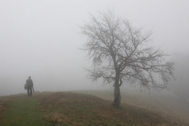 Lonely man in foggy day