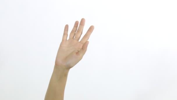 Közelkép a női kéz mutatja integető búcsú a fehér háttér.