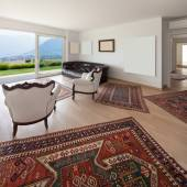 Obývací pokoj s bílým křesla