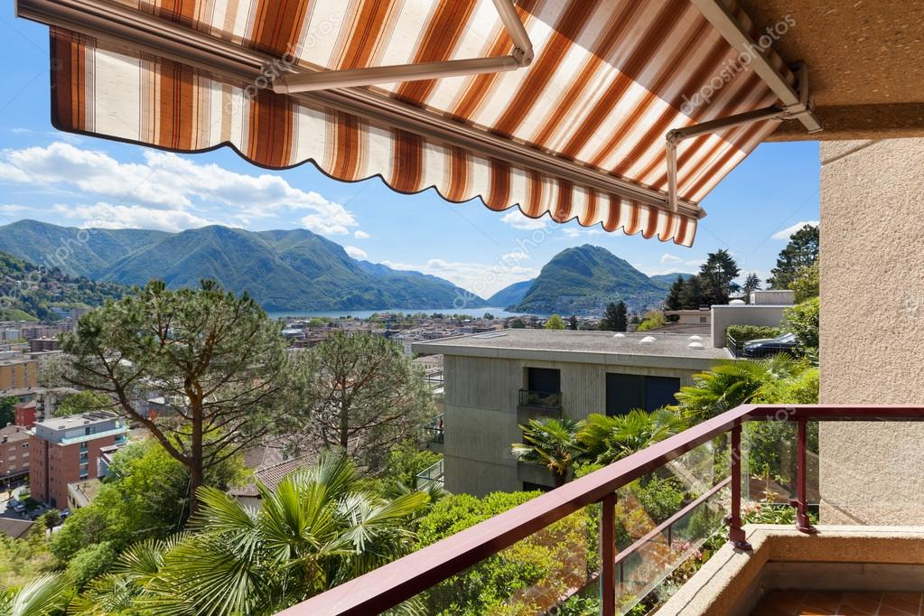 Balcony with sun shade — Stock Photo © Zveiger #115565886