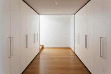 Interior, long corridor with wardrobes