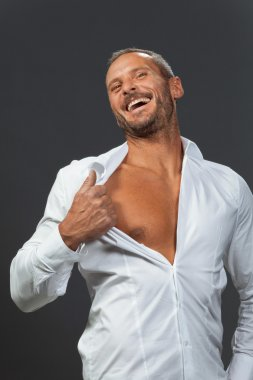 adult muscular man showing his chest