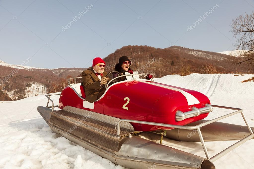 Sweet and weird couple surfing on a pedalos in winter time ( not