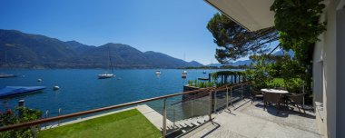 Lake view from the balcony of modern villa, summer