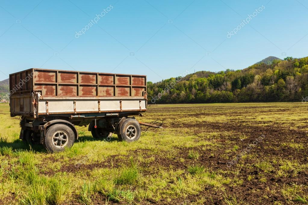 Countryside landscape with wagon for agriculture