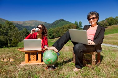 business women working in nature