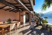 Fotografie dům, verandu při západu slunce