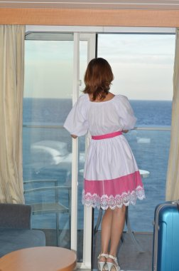 Woman on deck of a cruise liner looking at sea.  Caucasian woman, Back view .Cruise ship life. Travel concept.